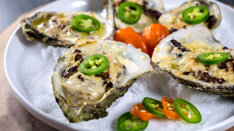 plate of grilled oysters with habanero butter