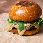 Grilled Lamb Burger sits on burger paper