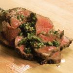 Freshly sliced picanha steak with Chimichurri sauce.