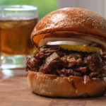 Lamb BBQ Sandwich with a glass of bourbon